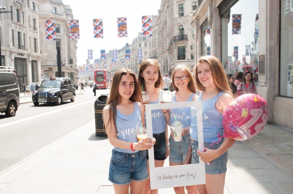 Teenage girls enjoying a Photo Party around London