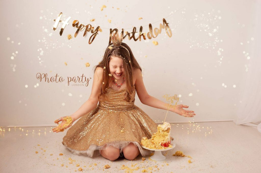Birthday girl with a gold birthday cake and glitter set